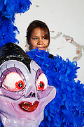 """San Miguel de Allende, Guanajuato, Mexico: Sandra Espinoza models her Ursula (LIttle Mermaid) costume which she and her brother made for El Dia de los Locos parade. """"The Day of the Crazies,"""" is a carnival during which groups in 4 different neighborhoods in this historical town dress up and dance in the street in honor of San Pasqual Bailon, the dancing saint. The Espinoza family has been creating papier mache heads and costumes for over 30 years; this year celebrating the bad guys in Disney films. 6/15/09 (photo: Ann Summa/Getty Images)."""