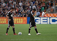 DC United's Chris Pontius (left) and Jaime Moreno stand stunned at midfield after Kenny Mansally's second goal of the night. DC United lost its 2010 opening match 2-0 to the visiting New England Revolution at RFK Stadium in Washington, D.C.