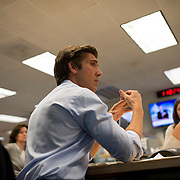 "August 29, 2014 - New York, NY : ABC News Anchor David Muir (foreground) takes part in an editorial meeting with producers at the ""World News Tonight with David Muir"" rim  in the ABC News building on West 66th Street on Friday afternoon. David Muir is taking over for Diane Sawyer as anchor of ABC's ""World News Tonight."" CREDIT: Karsten Moran for The New York Times"