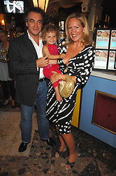 IMOGEN EDWARDS-JONES, her husband KENTON ALLEN and their daughter ALLEGRA at the launch party for her new book Beach Babylon held at Beach Blanket Babylon, Ledbury Road, London on 18th July 2007.<br />