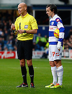 Picture by David Horn/Focus Images Ltd +44 7545 970036<br /> 07/12/2013<br /> Mr D Drysdale , Referee writes in his note book while Joey Barton of Queens Park Rangers prepares to take a free kick during the Sky Bet Championship match at the Loftus Road Stadium, London.