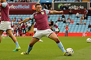 Aston Villa defender James Chester (12) warms up during the EFL Sky Bet Championship match between Aston Villa and Newcastle United at Villa Park, Birmingham, England on 24 September 2016. Photo by Alan Franklin.