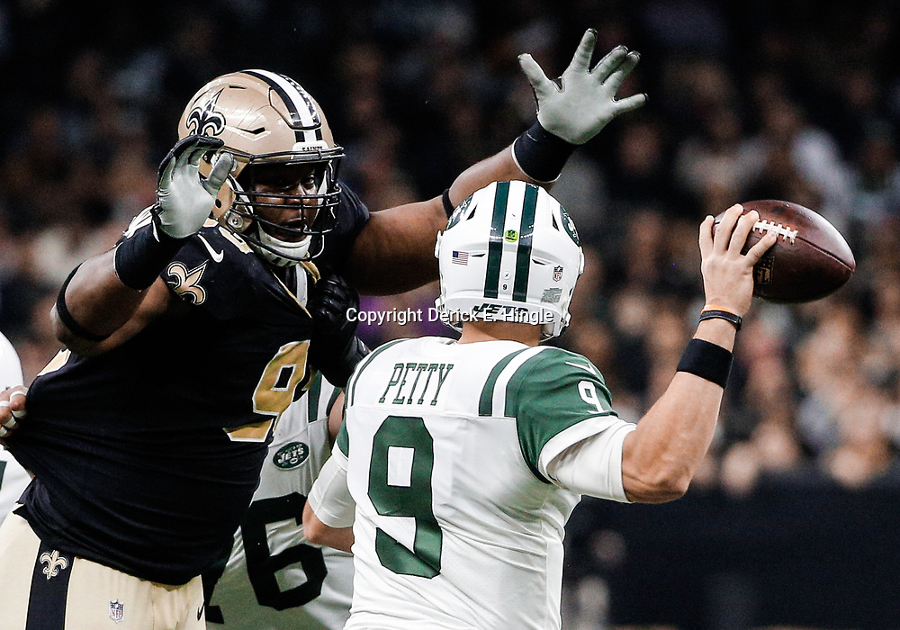 Dec 17, 2017; New Orleans, LA, USA; New Orleans Saints defensive tackle David Onyemata (93) pressures New York Jets quarterback Bryce Petty (9) during the second quarter at the Mercedes-Benz Superdome. Mandatory Credit: Derick E. Hingle-USA TODAY Sports