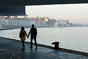 SANTANDER, SPAIN - April 18 2018 -  Couple walk hand in hand along Santander seafront, Northern Spain, Europe.