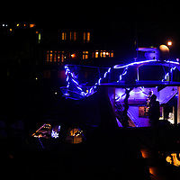 Boats boats anchor to watch the 31st Annual Holiday Flotilla boat parade Saturday November 29, 2014 at Wrightsville Beach, N.C. (Jason A. Frizzelle)