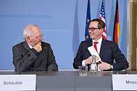 "16 MAR 2017, BERLIN/GERMANY:<br /> Wolfgang Schaeuble (L), CDU, Bundesfinanzminister, und Steven Terner ""Steve"" Mnuchin (R), Fianzminister der Vereinigten Staaten von Amerika, USA, im Gespraech, nach einer Pressekonferenz nach einem gemeinsamen Treffen, Bundesministerium der Finanzen<br /> IMAGE: 20170316-03-032<br /> KEYWORDS: Wolfgang Schäuble, Steve Mnuchin, Treasury secretary, Gespräch"
