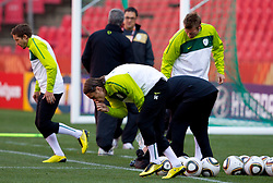 Zlatko Dedic of Slovenia touches grass and kisses the hand at the beginning of the training session at Ellis Park on June 17, 2010 in Johannesburg, South Africa. Slovenia will play their next FIFA World Cup Group C match against USA at Ellis Park in on Friday June 18, 2010, in Johannesburg, South Africa. (Photo by Vid Ponikvar / Sportida)