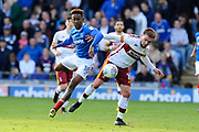 Jamal Lowe (18) of Portsmouth battles for possession with Paul Taylor (10) of Bradford City during the EFL Sky Bet League 1 match between Portsmouth and Bradford City at Fratton Park, Portsmouth, England on 28 October 2017. Photo by Graham Hunt.