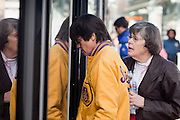 27 DECEMBER 2008 -- PHOENIX, AZ: People board a train at Roosevelt and Central. Metro Light Rail started running Saturday, Dec. 28. The light rail line is 20 miles long and cost $1.4 billion dollars. PHOTO BY JACK KURTZ
