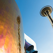 Exterior of Experience Music Project museum  with Space Needle reflected