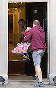 Photographer: Rick Findler<br /> <br /> London, UK. 08.05.16 Congratulatory flowers arrive at 10 Downing Street as David Cameron comes out triumphant in the 2015 general election.