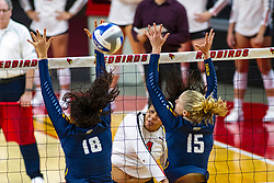 BLOOMINGTON, IL - September 15: Kaylee Martin strikes the ball past Gwyn Jones and Ellie Koontz during a college Women's volleyball match between the ISU Redbirds and the Marquette Golden Eagles on September 15 2019 at Illinois State University in Normal, IL. (Photo by Alan Look)