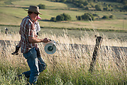 Installing an electric fence on a ranch in Oregon's Wallowa Valley.