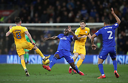 Cardiff City's Sol Bamba (centre left) and Preston North End's Alan Browne battle for the ball during the Sky Bet Championship match at The Den, London.