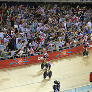 The Great Britain Men's pursuit team of Peter Kennaugh, Steven Burke, Geraint Thomas and Edward Clancy in action on their way to winning the Gold Medal in the Men's Team Pursuit competition during the track cycling at the Olympic Velodrome during the London 2012 Olympic games London, UK. 3rd August 2012. Photo Tim Clayton