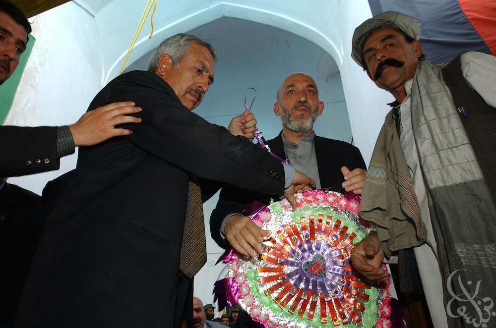 Interim Afghan leader Hamid Karzai receives a welcome wreath from a group of tribal elders May 04, 2002 in the southern Afghan city of Kandahar. The visit by Karzai to the city, his first since assuming power, is significant because of the city's history as a former Taliban stronghold.