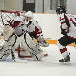 STOUFFVILLE, ON - Jan 16 : Ontario Junior Hockey League Game Action between the Stouffville Spirit Hockey Club and the Whitby Fury Hockey Club.  Daniel Mannella #31 of the Stouffville Spirit Hockey Club passes the puck during third period game action.<br /> (Photo by Michael DiCarlo / OJHL Images)
