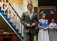 "Rodney Martel and Merdith Imbimbo as George and Winifred Banks with Kelli Powers as Mary Poppins and the children Jane and Michael on the stairs played by Isabella Cottrell and Jesse Powers during dress rehearsal for The Streetcar Company production of ""Mary Poppins"" at Interlakes High School auditorium.  (Karen Bobotas/for the Laconia Daily Sun)"