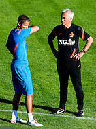 Dutch international football player Ibrahim Afellay with Coach Bert van Marwijk during the training for the trainingcamp of the Netherlands national football team in Hoenderloo on May 28, 2012. AFP PHOTO/ ROBIN UTRECHT