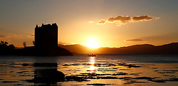 Castle Stalker on the west coast of Scotland silhouetted by the setting autumnal sun ....... (c) Stephen Lawson | Edinburgh Elite media