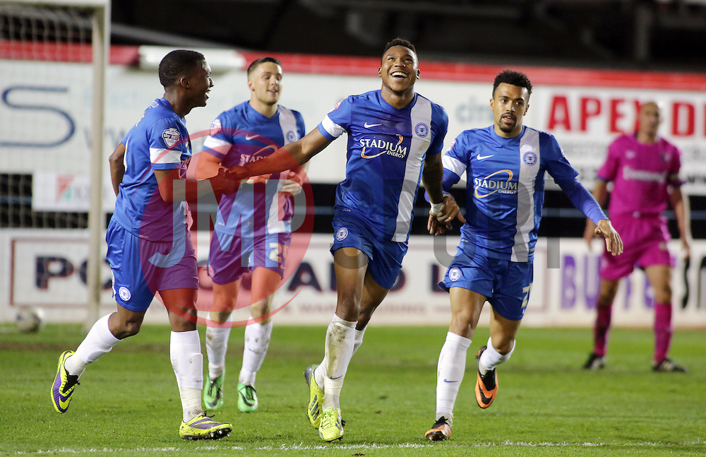 Peterborough United's Britt Assombalonga celebrates scoring  - Photo mandatory by-line: Joe Dent/JMP - Mobile: 07966 386802 08/04/2014 - SPORT - FOOTBALL - Peterborough - London Road Stadium - Peterborough United v Gillingham - Sky Bet League One