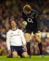 Photograph: Scott Heavey.<br />Arsenal v Tottenham Hotspur. FA Barclaycard Premiership. 08/11/2003.<br />Jens Lehman shouts at Helder Postiga