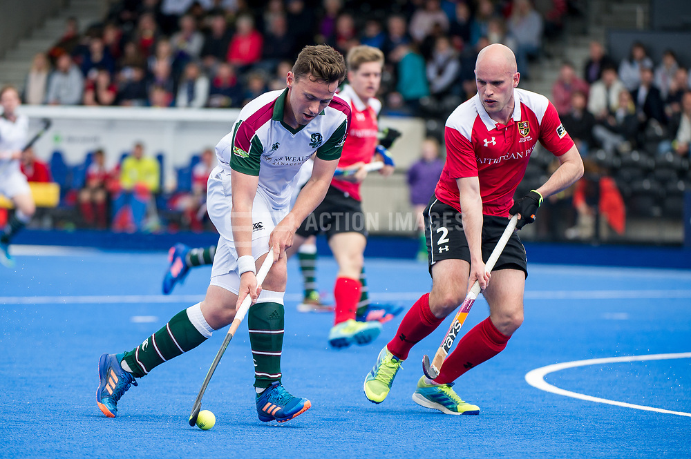 Surbiton's Alan Forsyth is watched by Martin Robbins of Holcombe. Holcombe v Surbiton - Semi-Final - Men's Hockey League Finals, Lee Valley Hockey & Tennis Centre, London, UK on 22 April 2017. Photo: Simon Parker