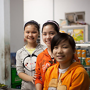 Young restaurant servers in Hue