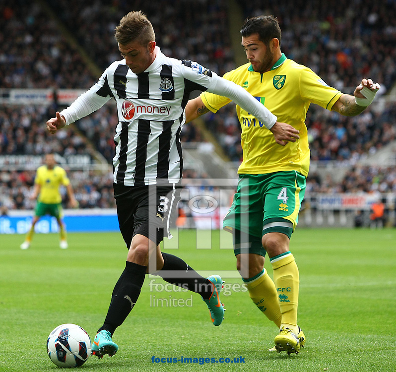 Picture by Paul Chesterton/Focus Images Ltd +44 7904 640267.23/09/2012.Bradley Johnson of Norwich and Davide Santon of Newcastle in action during the Barclays Premier League match at the Sports Direct Arena, Newcastle.