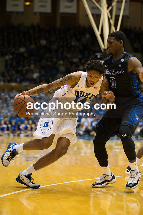 DURHAM, NC - DECEMBER 05: Brandon Ingram #14 of the Duke Blue Devils dribbles around Blake Hamilton #0 of the Buffalo Bulls during a 59-82 Duke Blue Devils win on December 05, 2015 at Cameron Indoor Stadium in Durham, North Carolina. (Photo by Peyton Williams/Getty Images) *** Local Caption *** Brandon Ingram;Blake Hamilton
