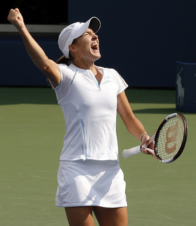 Justine Henin-Hardenne of Belgium reacts as she plays Jelena Jankovic of Serbia and Montenegro during their semifinal match on the twelveth day of the 2006 US Open tennis tournament in Flushing Meadows, New York Friday, 08 September 2006.