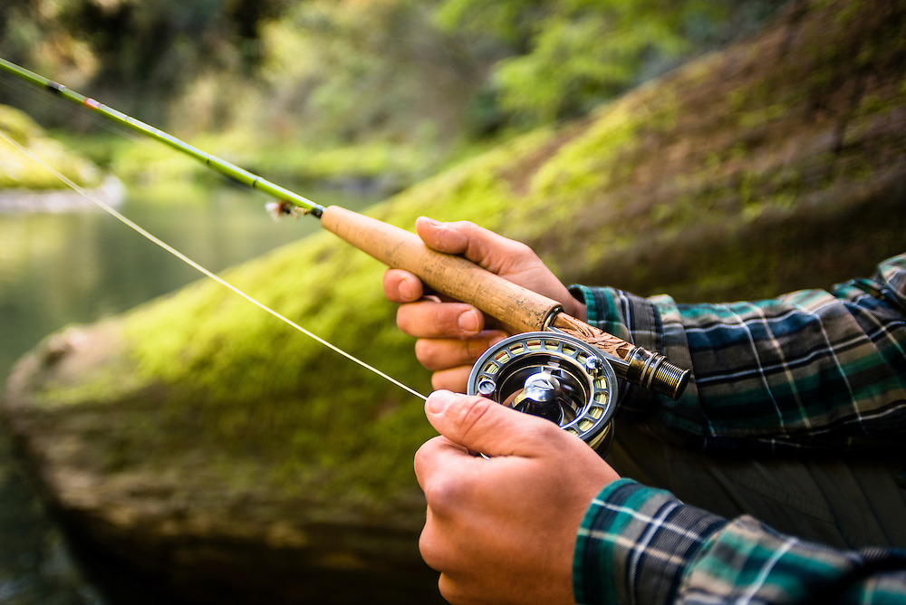 Holding a fly fishing rod on the Smith River
