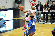 "Mississippi Lady Rebels guard Erika Sisk (5) shoots against Kentucky Wildcats guard Makayla Epps (25) at the C.M. ""Tad"" Smith Coliseum in Oxford, Miss. on Monday, February 23, 2015."