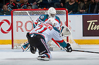 KELOWNA, CANADA - FEBRUARY 17: Devante Stephens #21 tries to block a shot as Michael Herringer #30 of the Kelowna Rockets makes a save against the Spokane Chiefs on February 17, 2017 at Prospera Place in Kelowna, British Columbia, Canada.  (Photo by Marissa Baecker/Shoot the Breeze)  *** Local Caption ***