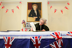 © Licensed to London News Pictures 10/04/2013.Valerie Holman, from Canterbury, had traveled to London to sign the condolence book, following the death of Margaret Thatcher, set up at the Finchley Conservatives Association in north London, ..London, UK.Photo credit: Anna Branthwaite