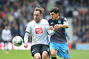 Derby County defender Richard Keogh (captain) battles with Sheffield Wednesday striker Fernando Forestieri during the Sky Bet Championship match between Derby County and Sheffield Wednesday at the iPro Stadium, Derby, England on 23 April 2016. Photo by Jon Hobley.