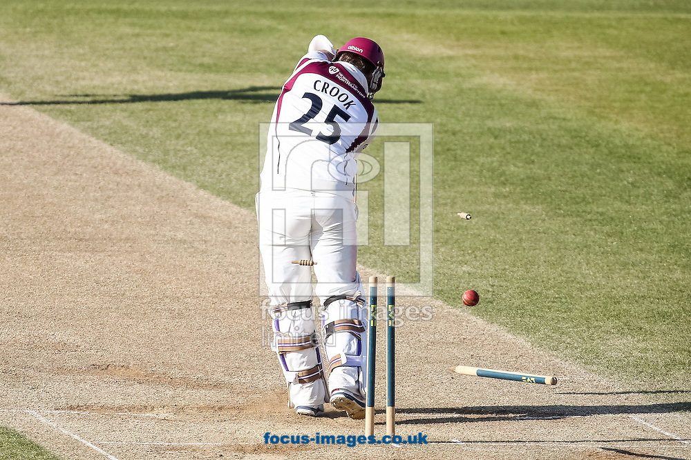Steven Crook of Northamptonshire County Cricket Club  is clean bowled by Jamie Harrison of Durham County Cricket Club (not shown) during day 4 of the LV County Championship Div One match at the County Ground, Northampton<br /> Picture by Andy Kearns/Focus Images Ltd 0781 864 4264<br /> 16/04/2014