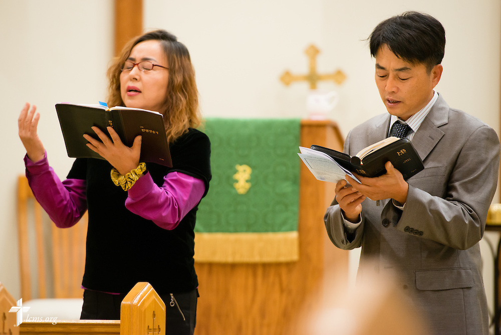 (L-R) Tabitha Back and Sang Mok Ko sing during Divine Service on Sunday, Nov. 23, 2014, at Living Faith Korean Lutheran Church in Cumming, Ga. LCMS Communications/Erik M. Lunsford