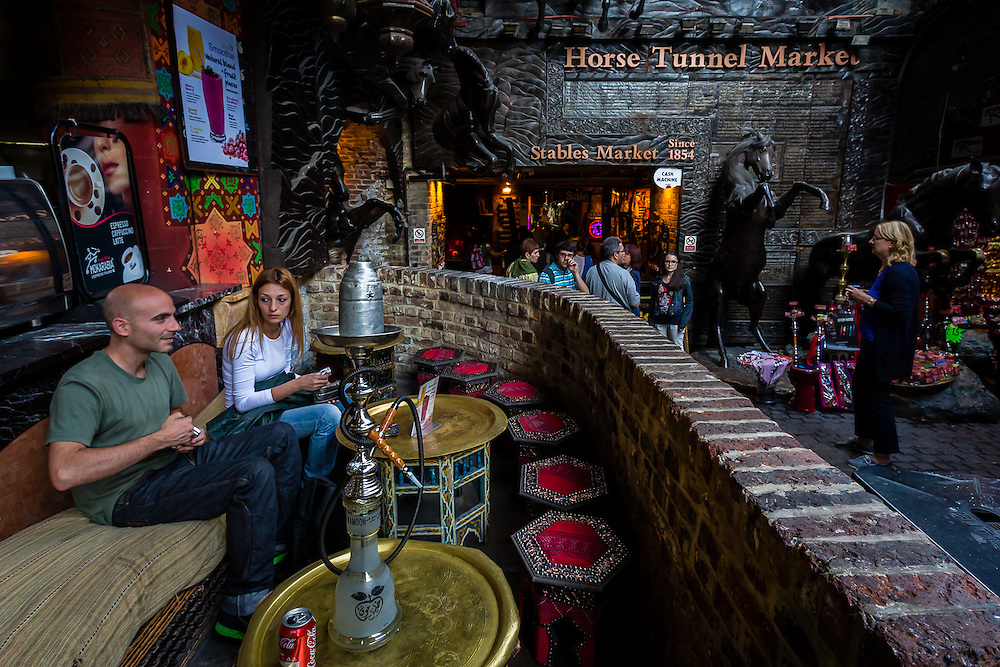 A couple enjoys a morning talk near the entrance to Horse Tunnel Market