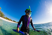 Woman in a wetsuit and snorkeling gear, Lady Elliot Island, Great Barrier Reef, Queensland, Australia