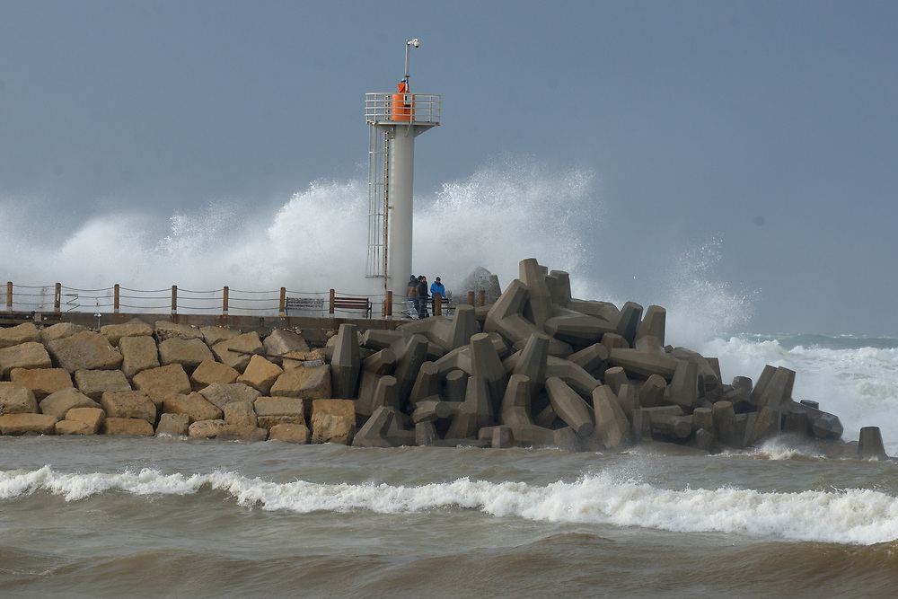 Waves break on the breakwater in the Israeli coastal city of Herzliya on January 05, 2018 as a storm hits the country. Photo by Gili Yaari