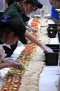 ZHENGZHOU, CHINA - JUNE 14: (CHINA OUT) <br /> <br /> Eight-Meter-Long Sandwich<br /> <br /> Staffs of Subway make an 8-meter-long sandwich at Guiren Street on June 14, 2014 in Zhengzhou, Henan province of China.<br /> ©Exclusivepix