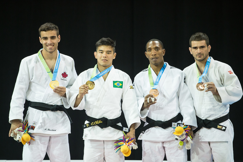 Gold medalist Charles Chibana (2nd Left) is joined by silver medalist Antoine Bouchard of Canada (L), and bronze medalists Fernando Gonzales  of Argentina(R) and Carlos Tondique of Cuba during the medal ceremony for the men's judo 66kg class at the 2015 Pan American Games in Toronto, Canada, July 12,  2015   AFP PHOTO/GEOFF ROBINS