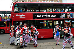 © Licensed to London News Pictures. 29/08/2016. London, UK. A group of carnival drummer board a bus after performing at day two of the Notting Hill carnival, the second largest street festival in the world after the Rio Carnival in Brazil, attracting over 1 million people to the streets of West London.  Photo credit: Ben Cawthra/LNP