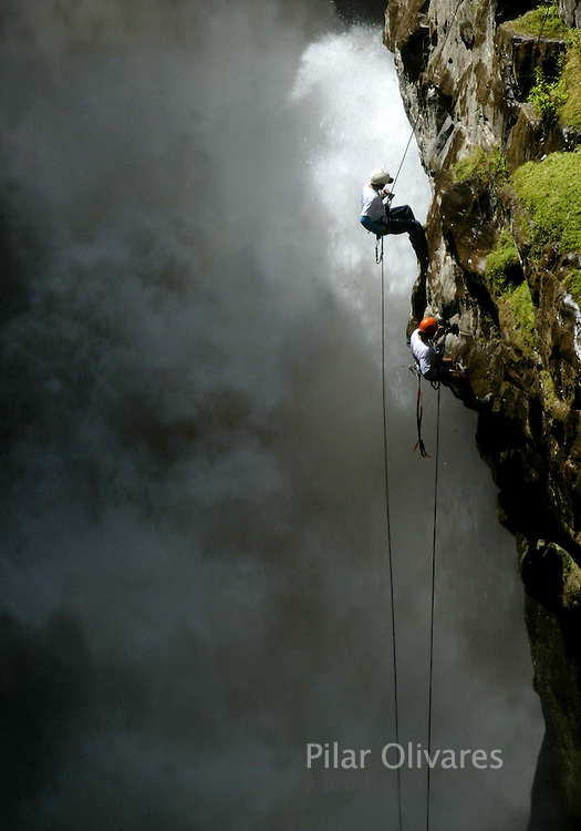 Peruvians climb a cliff at the Cotahuasi river during a competition at the Cotahuasi canyon in the city of Arequipa, southeast of Lima April 30, 2006. REUTERS/Pilar Olivares