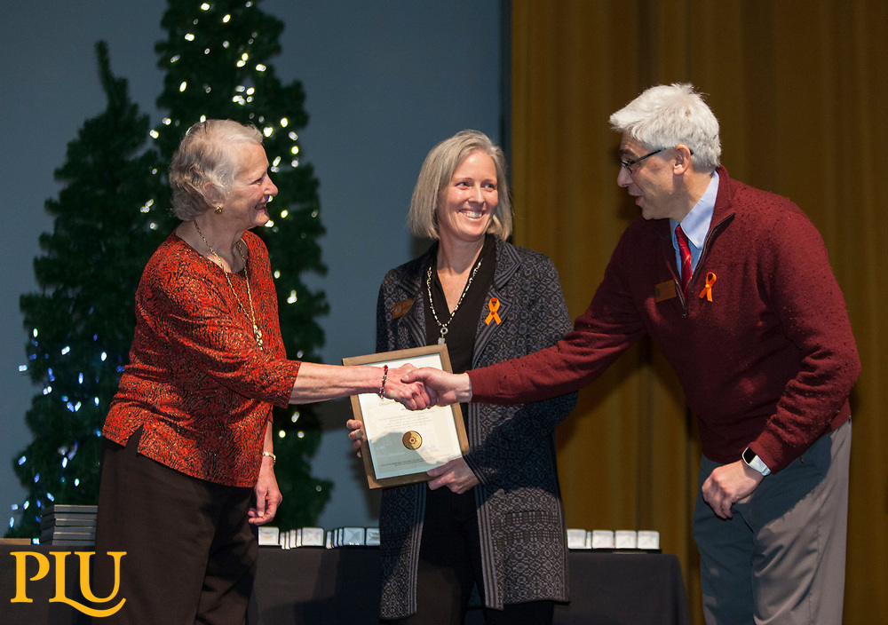 Carol Sheffels Quigg presents the Quigg award to the Department of Kinesiology represented by Karen McConnell and Harry Papadopoulos at the PLU Christmas Brunch, Thursday, Dec. 14, 2017. (Photo: John Froschauer/PLU)