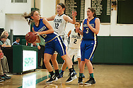 Vergennes' Caroline Johnston (15) tries to save the ball from going out of bounds while being guarded by Winooski's Lydia Nattress (12) during the girls basketball game between Vergennes and Winooski at Winooski High School on Wednesday night December 9, 2015 in Winooski. (BRIAN JENKINS/for the FREE PRESS)