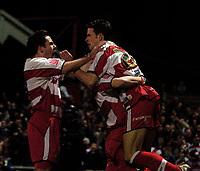 Photo: Jed Wee.<br /> Doncaster Rovers v Arsenal. Carling Cup. 21/12/2005.<br /> <br /> Doncaster celebrate with goalscorer Michael McIndoe (R).
