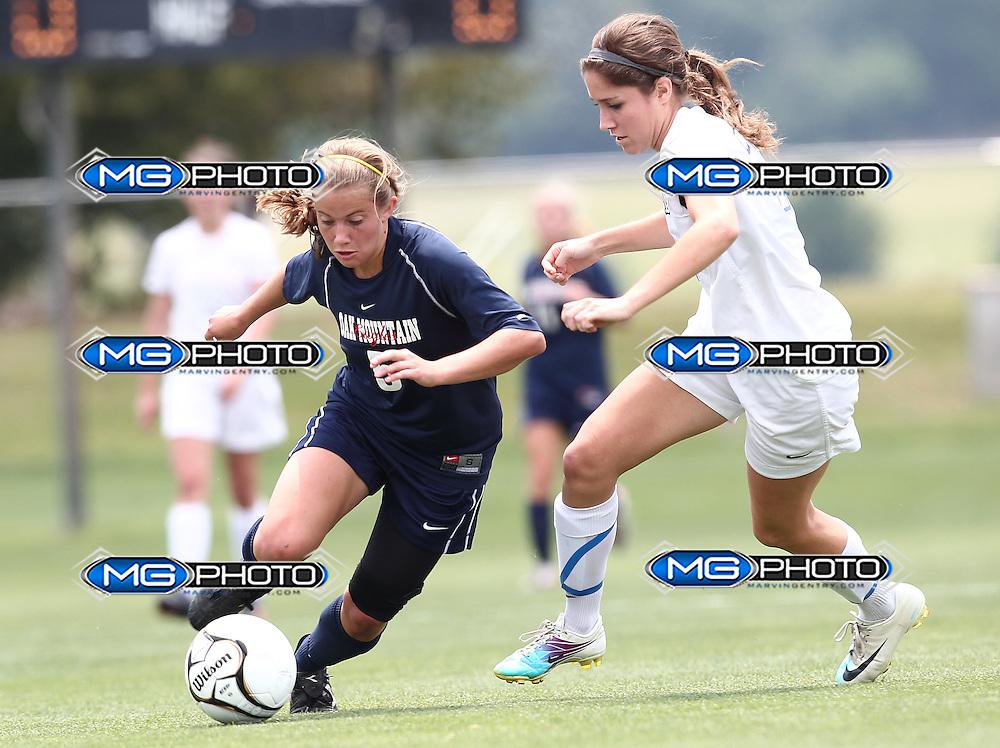 May 12, 2012; Huntsville, AL, USA;  Oak Mountain's Vicki Hill (5) controls the ball Auburn's Katelyn Patrick (24).Mandatory Credit: Marvin Gentry