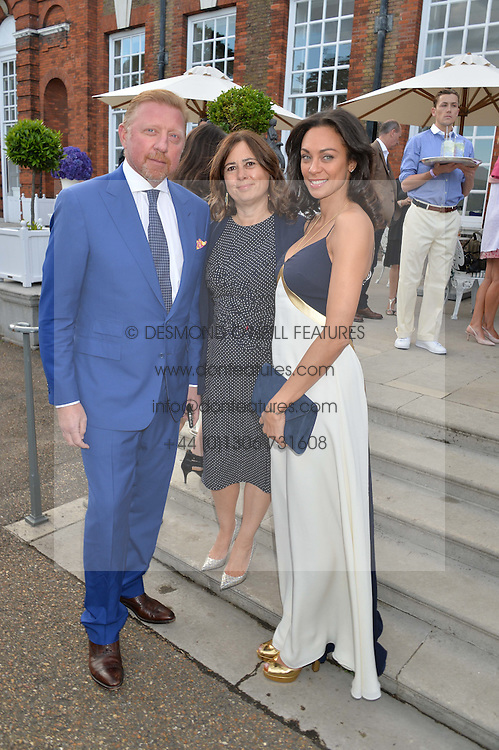 Left to right, BORIS BECKER, ALEXANDRA SHULMAN and LILLY BECKER at The Ralph Lauren & Vogue Wimbledon Summer Cocktail Party at The Orangery, Kensington Palace, London on 22nd June 2015.  The event is to celebrate ten years of Ralph Lauren as official outfitter to the Championships, Wimbledon.
